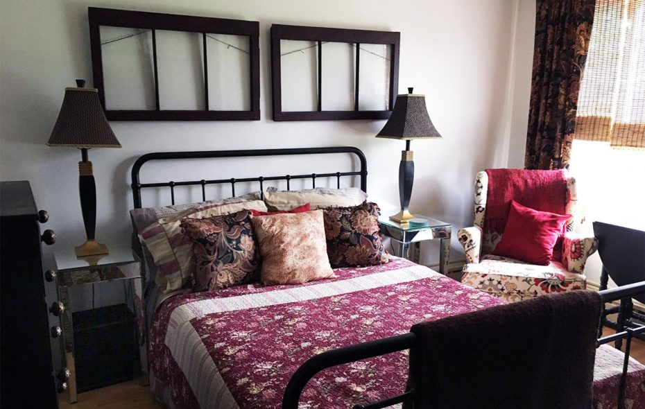 Susan Cherry Redino uses window frames all over the house as decorative accents. She gave the two frames above the bed in the guest room a crackle finish. (Photo courtesy Susan Cherry Redino)