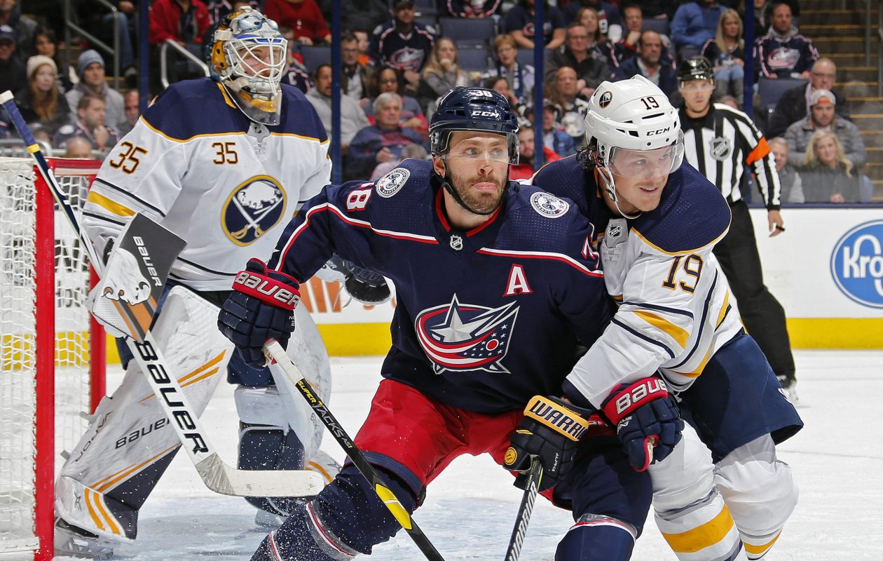 Columbus winger ' Boone Jenner (38) battles for position against Sabres defenseman Jake McCabe (19) during the first period at Nationwide Arena (Kyle Robertson/Columbus Dispatch/TNS)