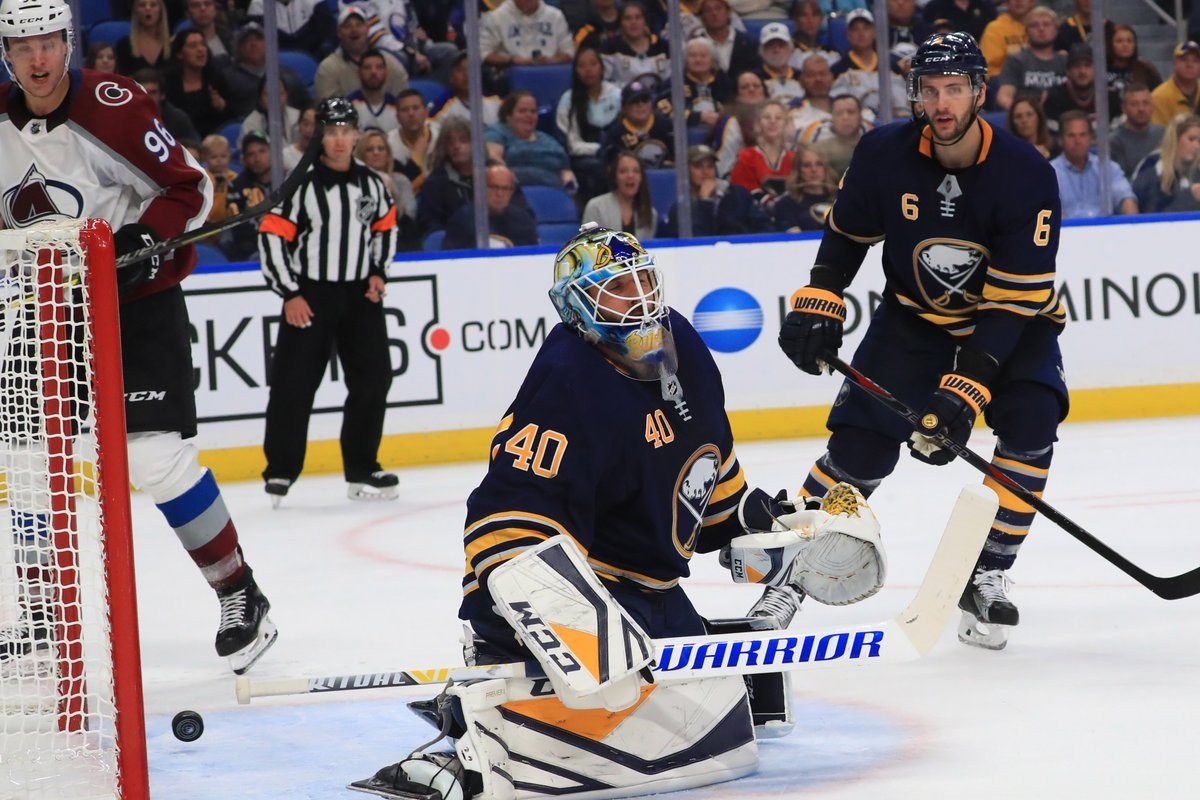 Carter Hutton and Marco Scandella can't do anything to stop Nathan MacKinnon's second-period goal. (Sharon Cantillon/Buffalo News)