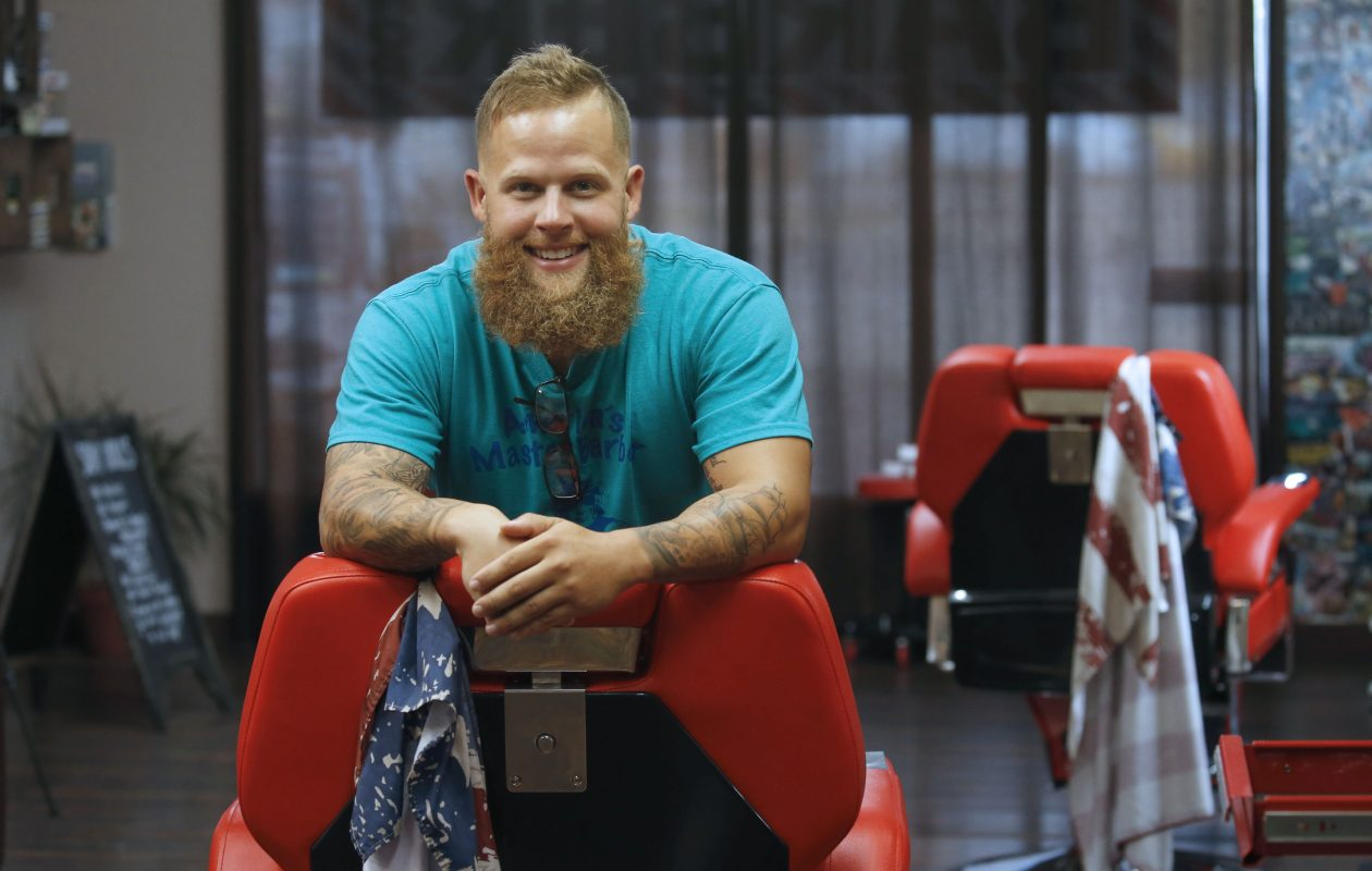 Jason Lape, photographed at The Razor's Edge Barber Shop in Hamburg, went on a cross-country blitz after barber school to learn the latest barber styles and documented his adventure on social media as a way to build buzz around his new career. (Robert Kirkham/Buffalo News)