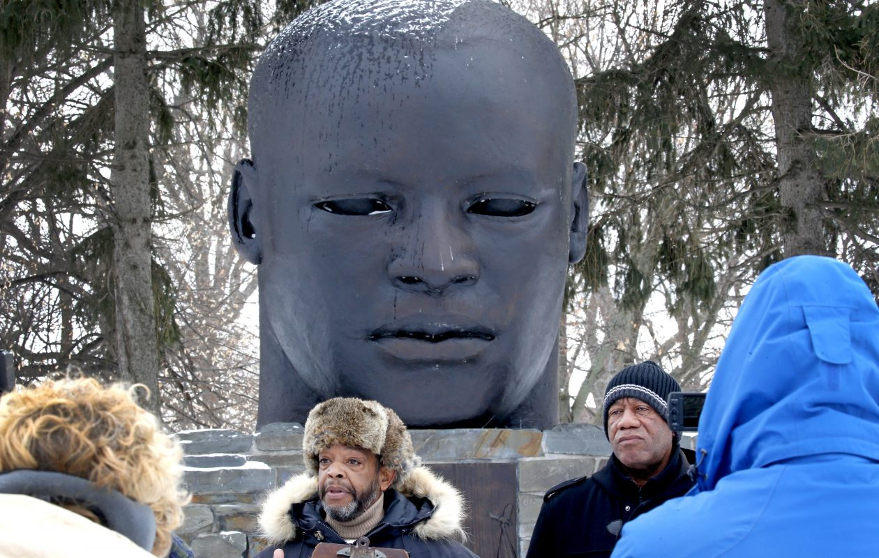 Samuel A. Herbert, left, standing with fellow activist Sylvester Herald, announced their plans on  Jan. 15, 2018, for a project to replace the Martin Luther King bust statue at Buffalo's MLK Park with an alternative statue that matches more the likeness of the fallen legend. (Robert Kirkham/Buffalo News)
