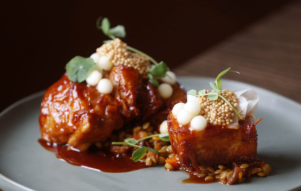 Grilled pork shoulder and belly with chile-infused apple marbles at Prescott's Provisions. (Mark Mulville/Buffalo News)