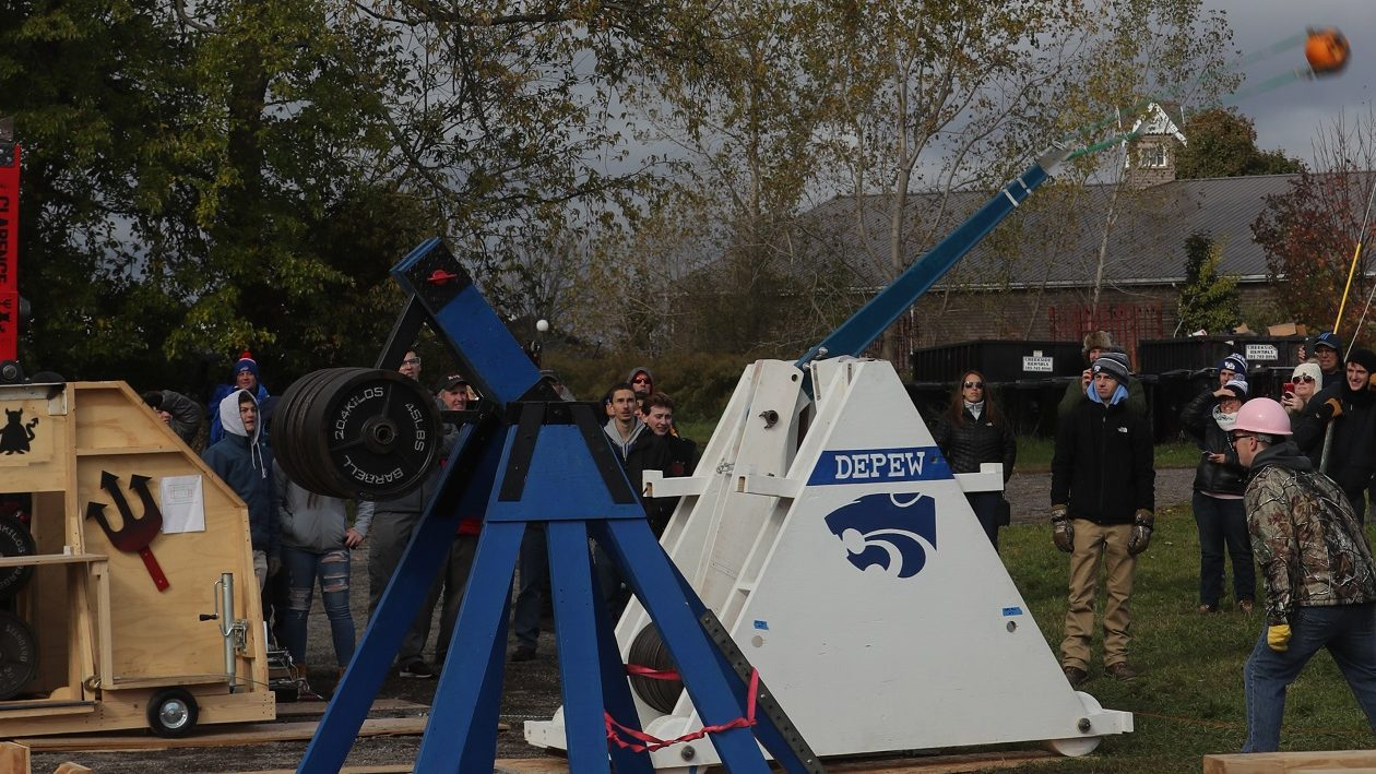 Technology students from Depew High School bested those from a dozen other Western New York school districts during the 13th annual trebuchet contest on Sunday at the Great Pumpkin Farm in Clarence.  (John Hickey/Buffalo News)