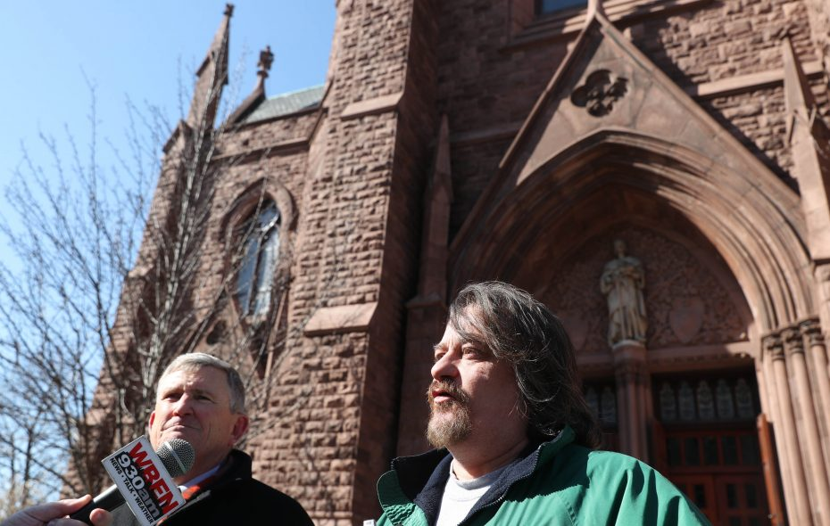 """It means the world to me, especially for victims, to see all of this exploding as big as it has, as fast as it has,"" says Michael Whalen, right, Friday after returning to the same spot outside St. Louis Church on Main Street where he first publicly accused a priest of molesting him as a boy.  This file photo was taken in February when he appeared outside the church with advocate Robert Hoatson from Road to Recovery Inc., at left.  (Sharon Cantillon/Buffalo News file photo)"