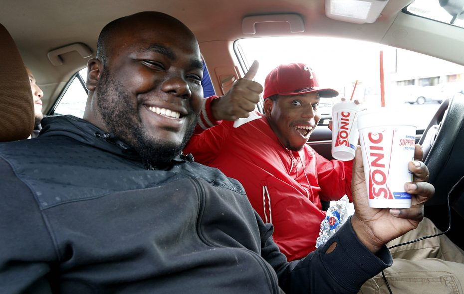 Jamel Clark, left, and Cameron Young hold drinks containing the chewiest, most perfect ice on the planet. (Robert Kirkham/Buffalo News)