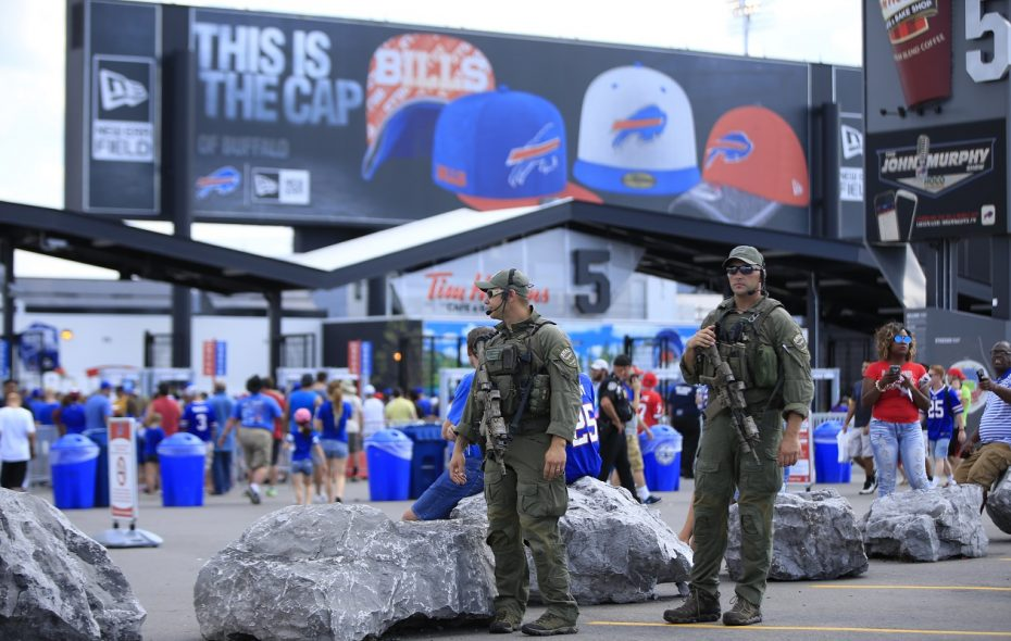Erie County SWAT team members Ben Pisa and Matt Noecker outside New Era Field before a 2016 preseason game. Additional police personnel will be in and around the stadium on Monday night. (Harry Scull Jr./News file photo)