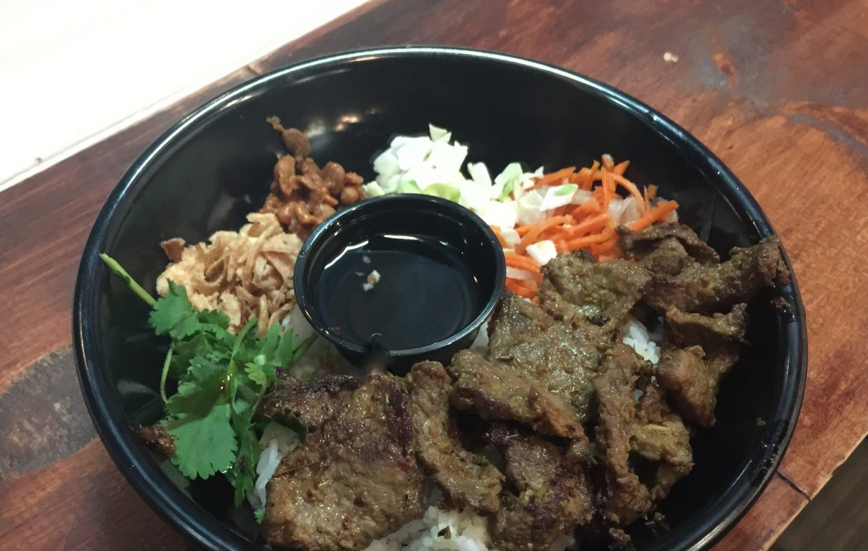 Cambodian beef bowl with fried shallots, salted soybeans, and vegetables at Yey's Cafe. (Andrew Galarneau/Buffalo News)