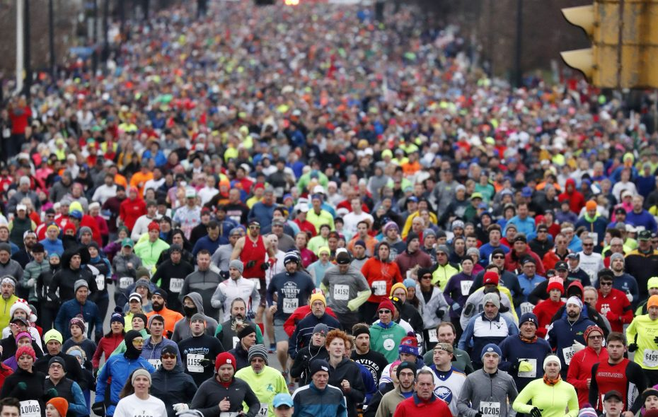 Racers run in the 122nd annual YMCA Turkey Trot  last Thanksgiving. (Mark Mulville/News file photo)