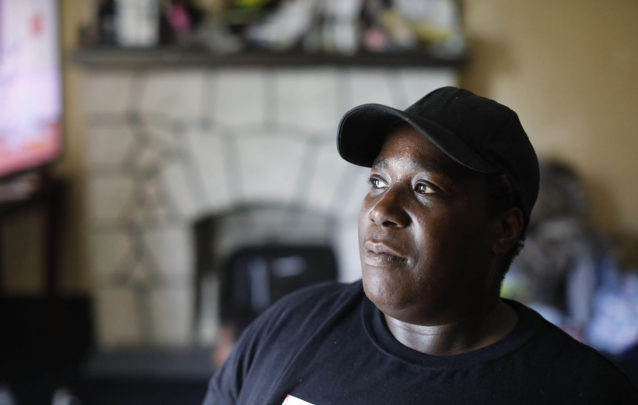 Tammy Applewhite is one of many recipients of public assistance who must pay back money inadvertently received from Social Services. (Derek Gee/Buffalo News)