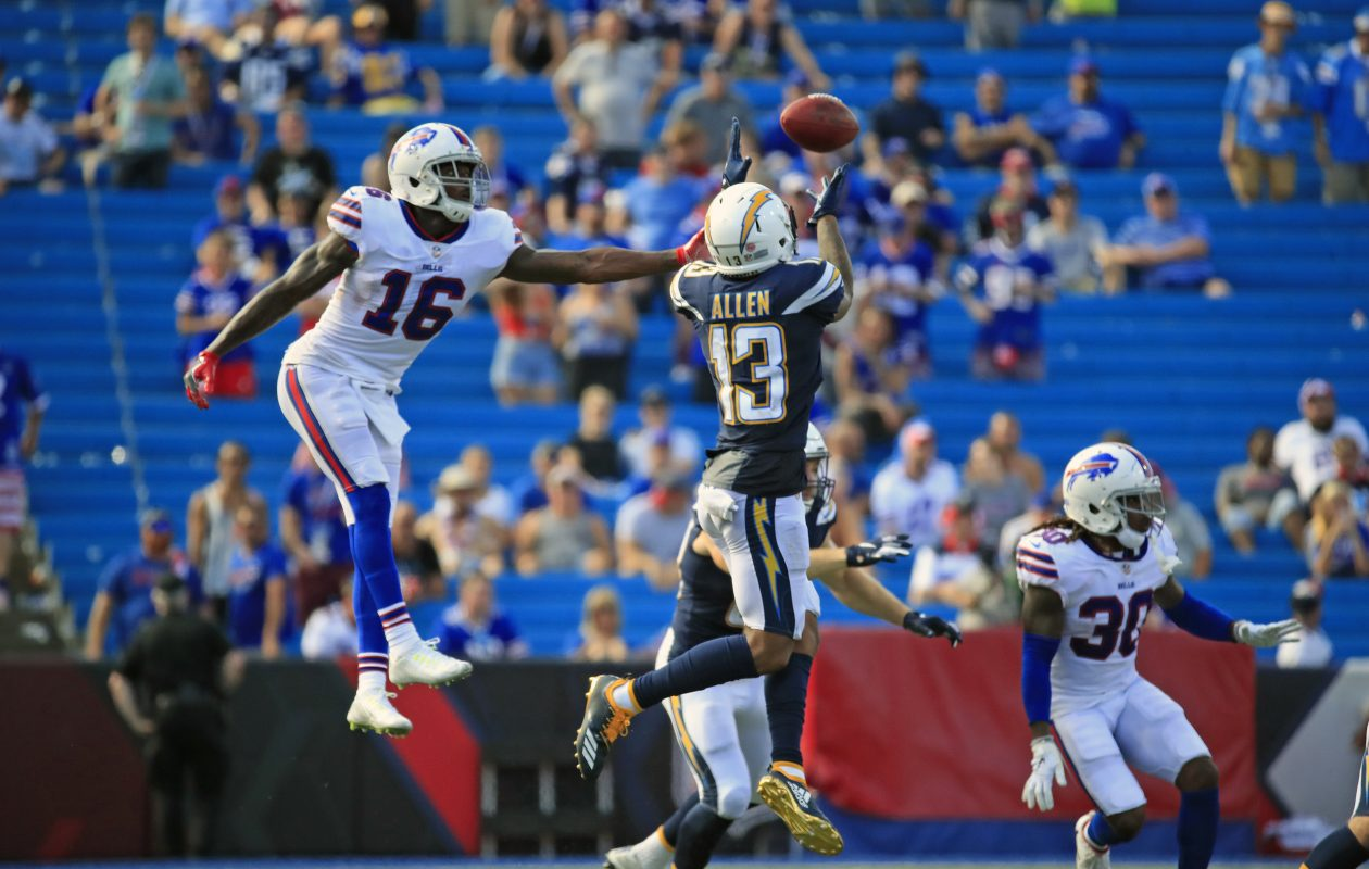 Robert Foster is unable to  reach an onside kick by the Bills that bounced to the Chargers' Keenan Allen (Harry Scull Jr./ Buffalo News)