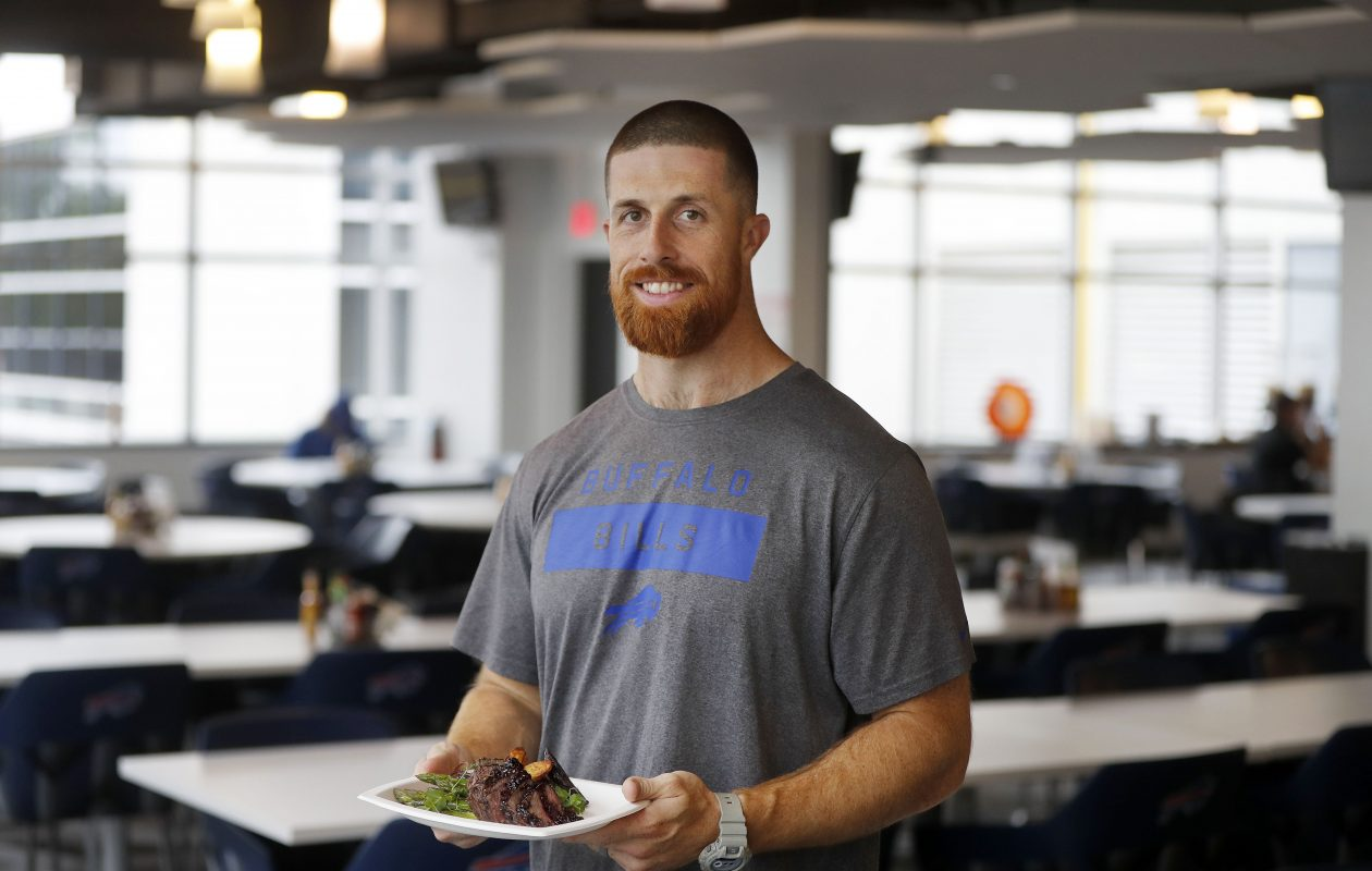 Buffalo Bills Assistant Strength and Conditioning coach Will Greenberg with a plate of venison tenderloin and potato wedges at the team facility (Mark Mulville/Buffalo News)