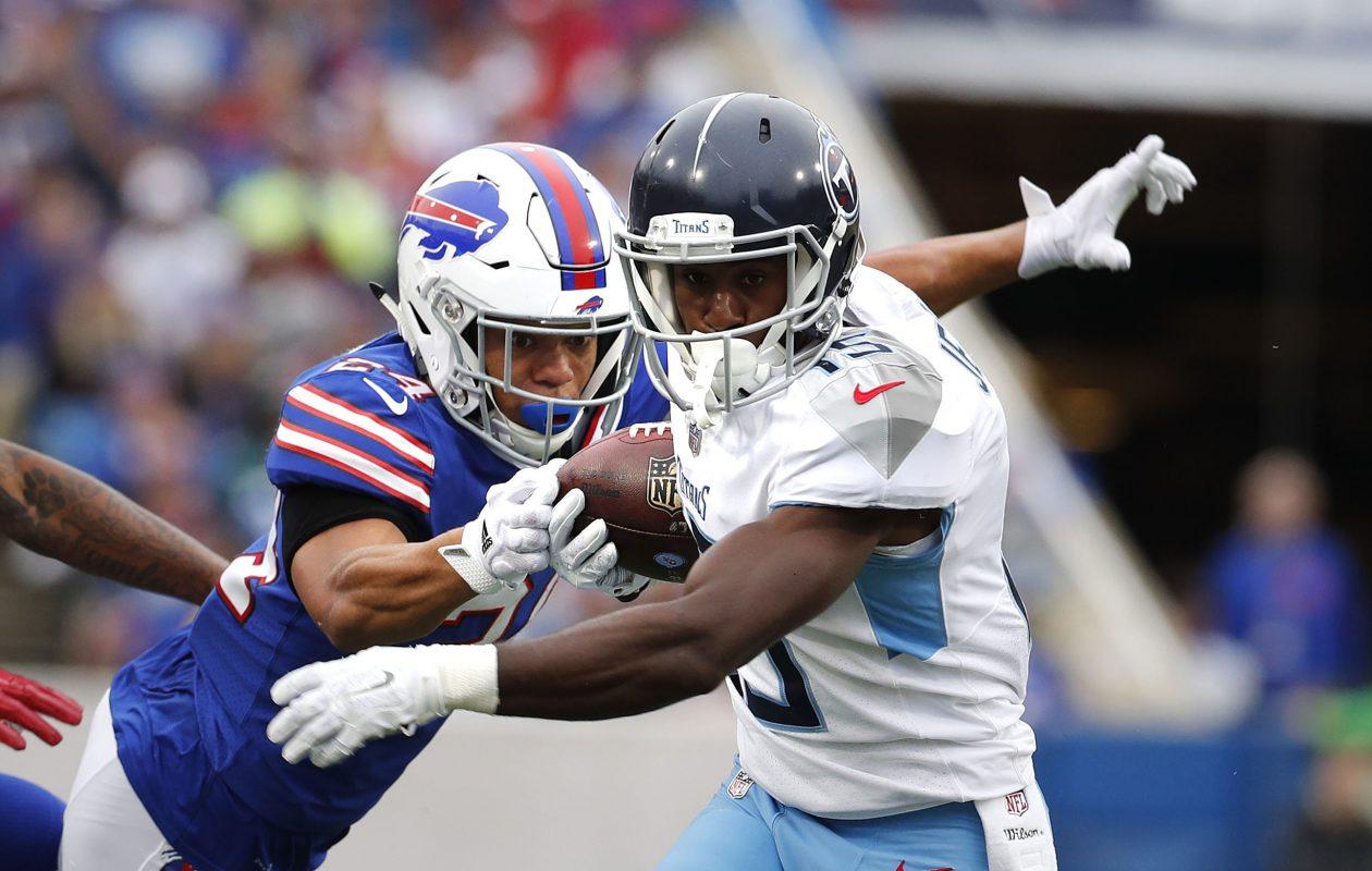 Bills cornerback Taron Johnson tries to strip the ball from Titans wide receiver Darius Jennings. (Mark Mulville/News file photo)
