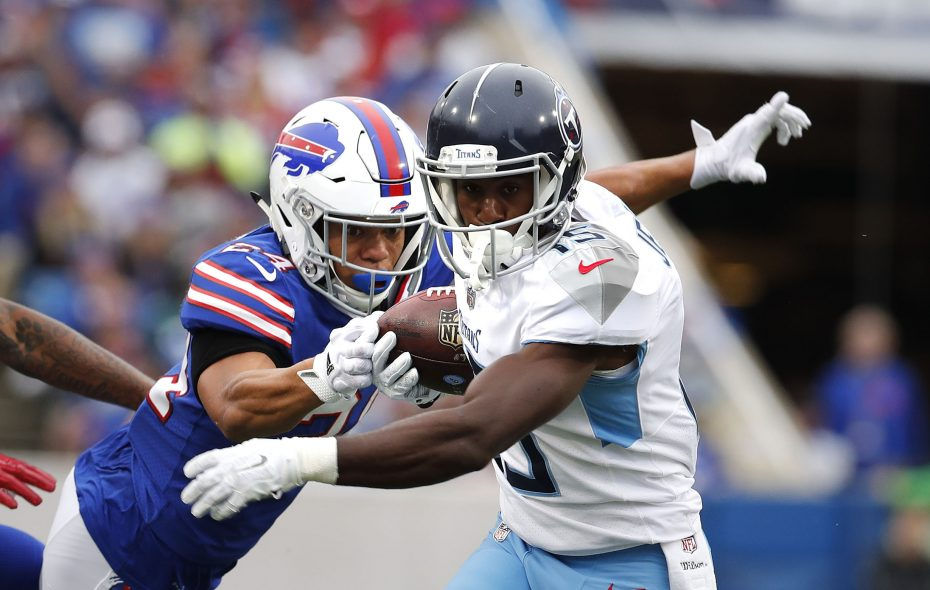 Bills cornerback Taron Johnson tries to strip the ball from Titans wide receiver Darius Jennings. (Mark Mulville/News file photo)