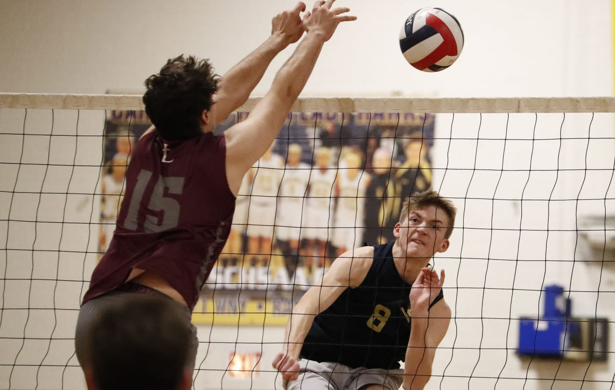 Canisius' Connor Booth spikes the ball past St. Joe's Jack Gugino during the Monsignor Martin boys volleyball championship match at Cardinal O'Hara High School Thursday. (Mark Mulville/Buffalo News)
