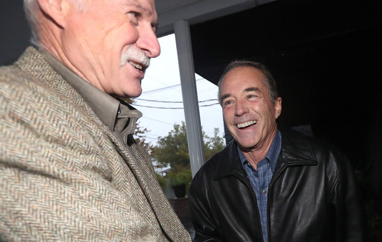 Chris Collins is greeted by people outside Lucarelli's Banquet Center in Lackawanna, where he appeared at a fundraiser for David DiPietro on Nov. 1. Here, he talks to Tom Edington. (Sharon Cantillon/Buffalo News)