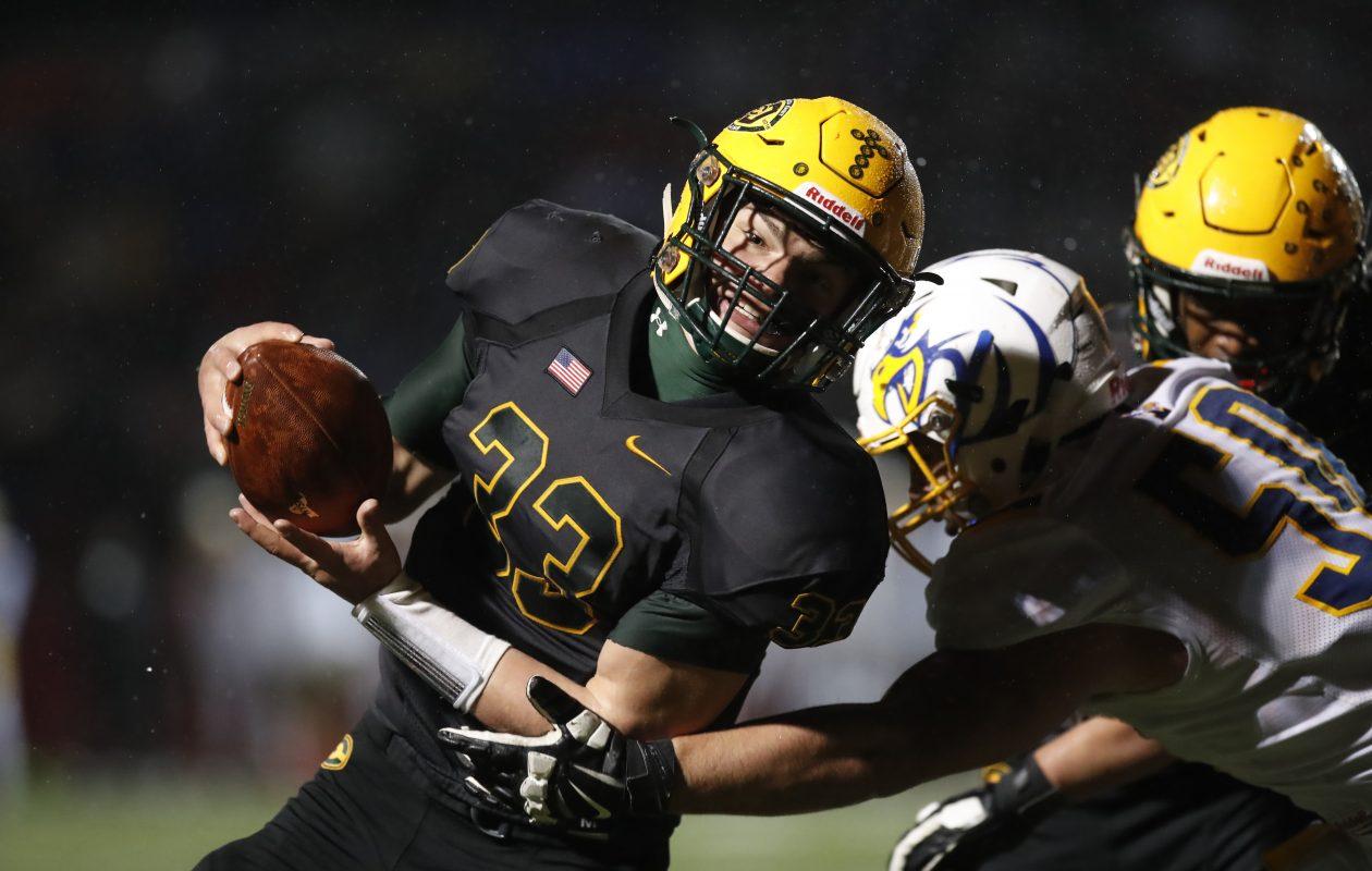 West Seneca East quarterback Shaun Dolac scores on a two-point conversion against Irondequoit during last week's Far West Regional. (Harry Scull Jr./Buffalo News)
