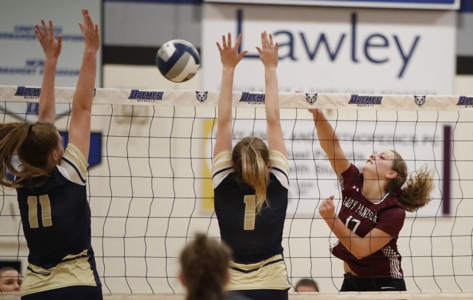 Portville player Sierra Keim (right) tries to hit through a Skaneateles block attempt during the NYSPHSAA Section VI Class C Subregional at Daemen College on Wednesday, Nov. 7, 2018. (Harry Scull Jr./ Buffalo News)