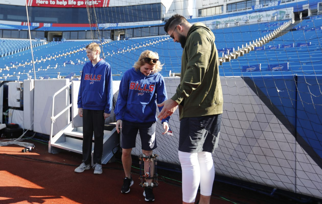 UB track athlete Allison Mazur meets Chicago Bears' Zach Miller on the field before the game at New Era Field    (Mark Mulville/Buffalo News)