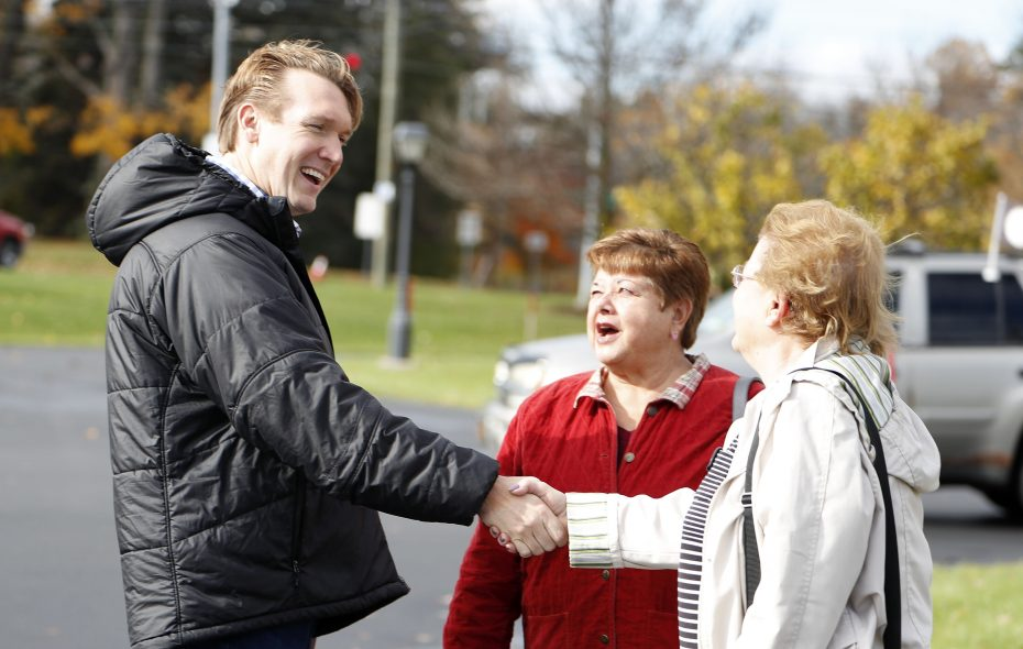 Democrat Nathan McMurray greets voters outside the Watermark Wesleyan at McKinley polling place in Hamburg on Election Day. (Mark Mulville/Buffalo News)