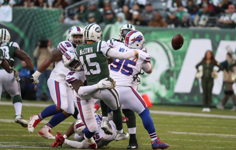 Bills defensive end Jerry Hughes pressures Jets quarterback Josh McCown  into trowing an incomplete pass (James P. McCoy/Buffalo News)