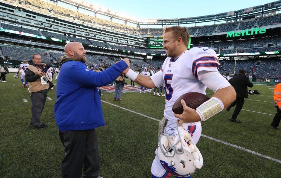 Matt Barkley walks off the field  and hugs offensive coordinator Brian Daboll after the game at MetLife Stadium. (James P. McCoy/Buffalo News)