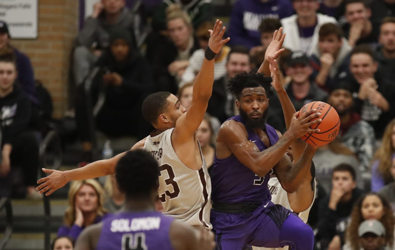 St. Bonaventure defender Jalen Poyser covers Niagara University guard James Towns during first half action at the Gallagher Center on Monday, Nov. 12, 2018. (Harry Scull Jr./ Buffalo News)
