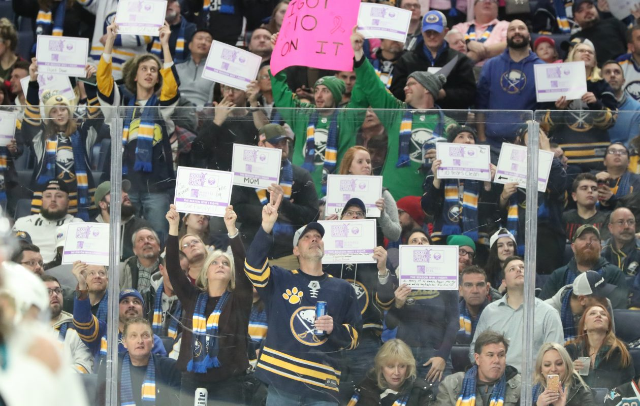 Buffalo Sabres fans hold up Hockey Fights Cancer signs in the second period at KeyBank Center on Tuesday, Nov. 27, 2018.  (James P. McCoy/Buffalo News)