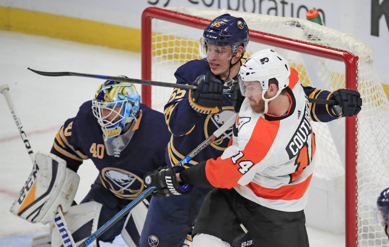 Defenseman Rasmus Ristolainen battles with Philadelphia's Sean Couturier in front of goaltender Carter Hutton during the second period (Harry Scull Jr./Buffalo News).