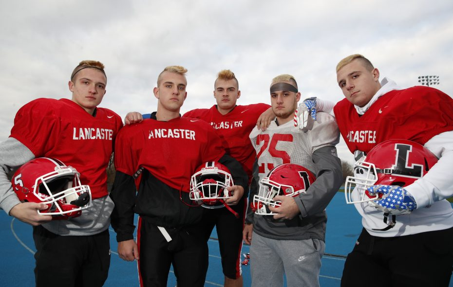 Lancaster football players, from the left, Ethan Jurkowski, Matt Marschner, Greg Marks, David Gaca and Dominic Chiarmonte show off their mohawks prior to Thursday's practice. (Harry Scull Jr./ Buffalo News)
