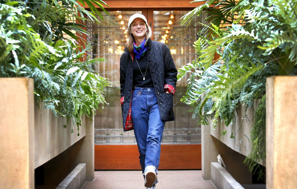 Caitlin Deibel wears a favorite outfit in the conservatory at Frank Lloyd Wright's Martin House. The once-demolished conservatory was reconstructed in recent years along with the pergola and carriage house, as part of the Martin House $50 million restoration. (Robert Kirkham/Buffalo News)