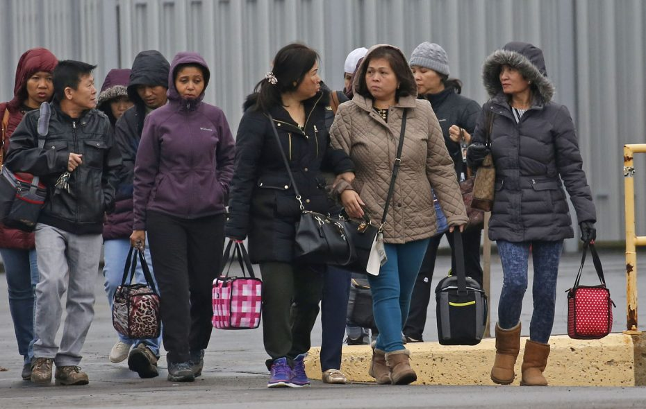 Employees leave New Era Cap in Derby shortly after they were informed the facility will be closing in March 2019. (Robert Kirkham/Buffalo News)