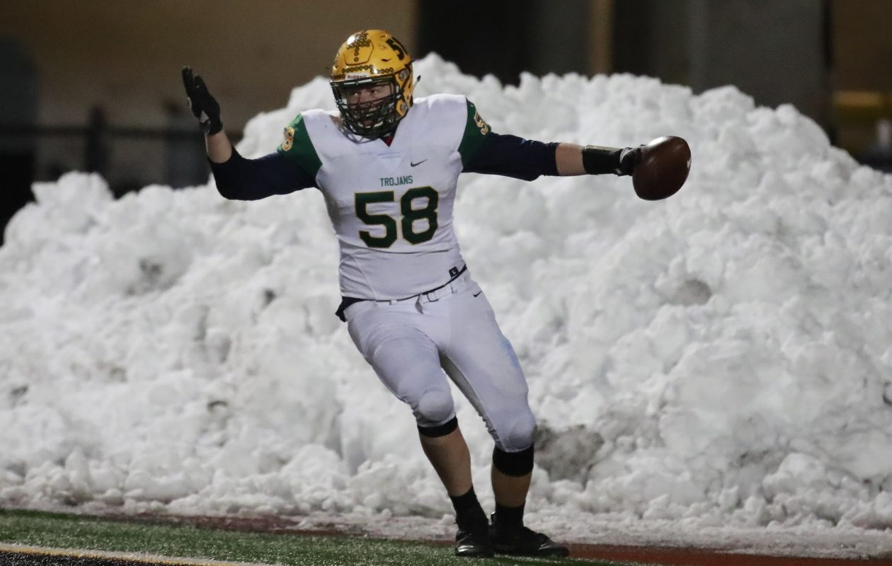 West Seneca East's Cam Cacciotti celebrates after returning a fumble for a touchdown during last week's NYSPHSAA Class A semifinal win over Indian River at Ty Cobb Stadium in Union-Endicott High School. (Harry Scull Jr./ Buffalo News)