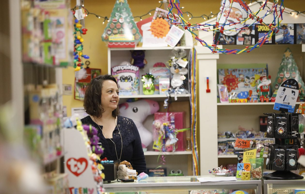Owner Crystal Newman wraps presents for a customer at Bloomsbury Lane Toy Shoppe in the Village of Lancaster. (Derek Gee/Buffalo News)