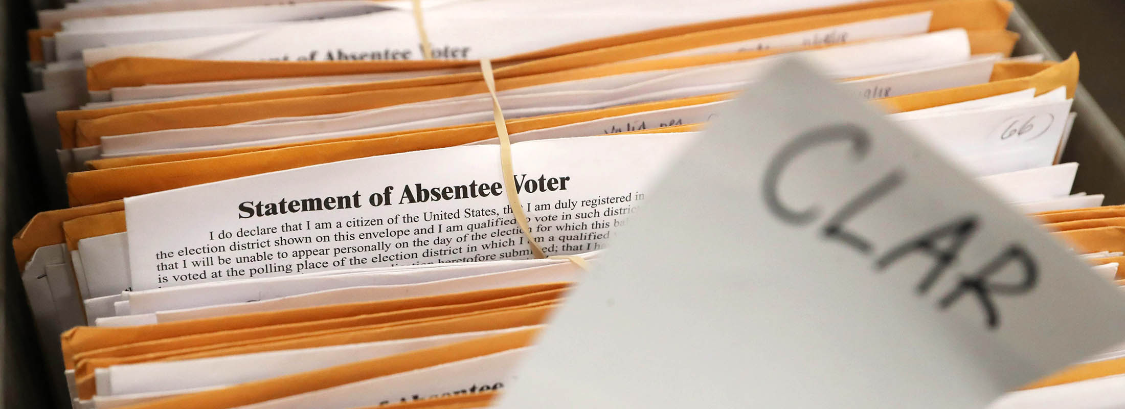A bipertisan team from the Erie County Board of Elections began their count of the 2018 absentee ballots, Tuesday, Nov. 20, 2018. They began with the 5588 ballots from the 27th District. A cart is filled with ballots. These are ballots from Clarence. (Sharon Cantillon/Buffalo News)