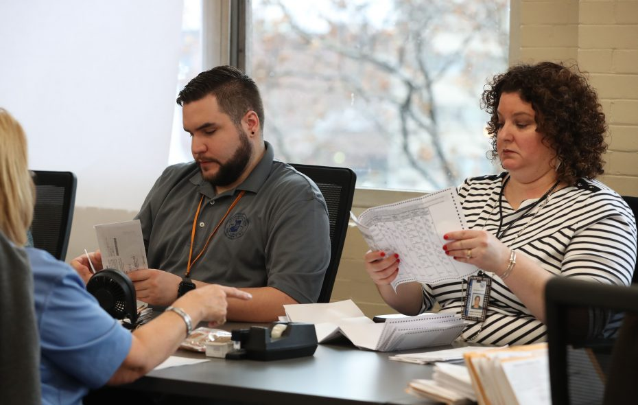 A bipartisan team from the Erie County Board of Elections began its count of the 2018 absentee ballots on Tuesday, Nov. 20, 2018. (Sharon Cantillon/News file photo)