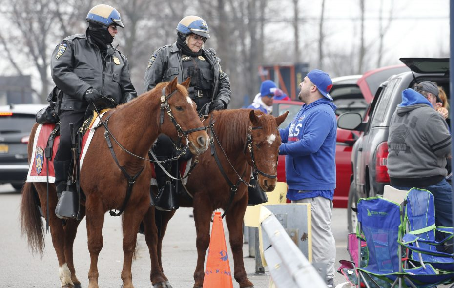 Erie County Sheriff mounted deputies visit with fans prior to Sunday's game. Following the game, a deputy who was directing traffic was struck. (Derek Gee/Buffalo News)