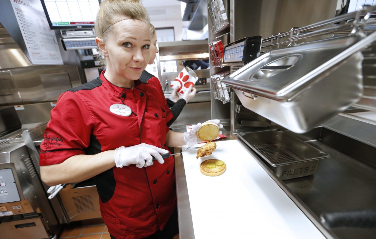 Trainer Vanessa Brown, of Amarillo, Texas, makes a chicken sandwich during a media preview day at the new Cheektowaga restaurant Tuesday. The restaurant opens at 6:30 a.m. Thursday. (Robert Kirkham/Buffalo News)
