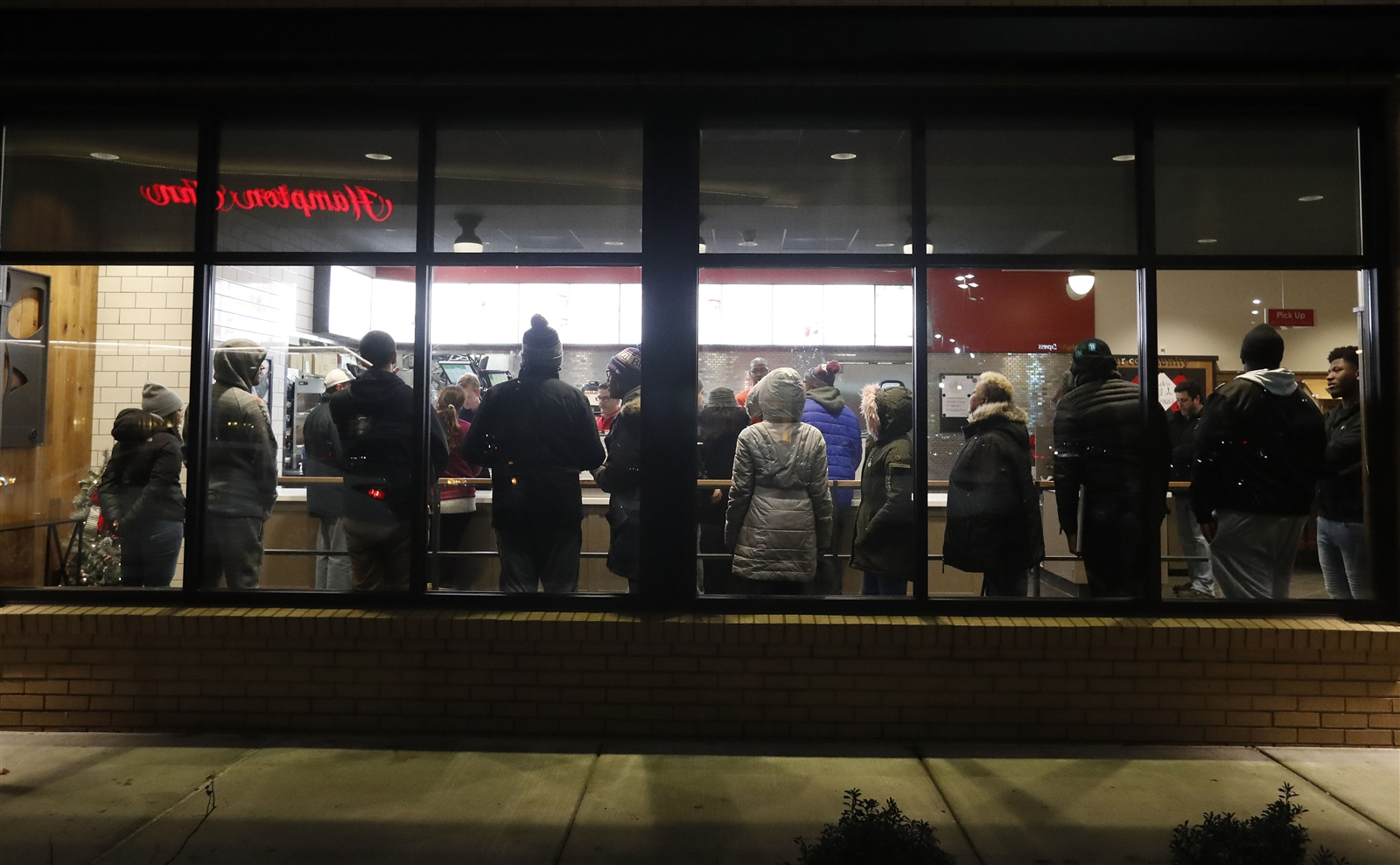 Chicken for breakfast? The sun wasn't up yet but eager customers line up to be served as the first Chick-fil-A restaurant in Western New York opened today in Cheektowaga. (Mark Mulville/Buffalo News)