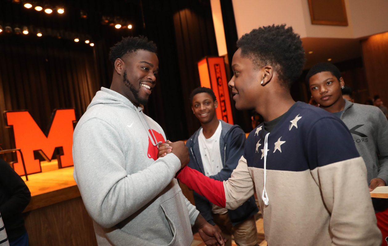 Shaq Lawson spoke to students at McKinley High School about who are part of the Gentlemen's Institute, a 7-week leadership enrichment program, on Tuesday, Nov. 27, 2018. Afterward he greets Savion Simmons and the other students. In back at center is Corey Jackson. (Sharon Cantillon/Buffalo News)