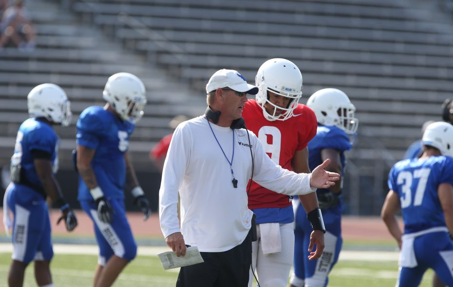 UB football coach Lance Leipold, left, talks with quarterback Dominic Johnson during a preseason scrimmage. (John Hickey/News file photo)