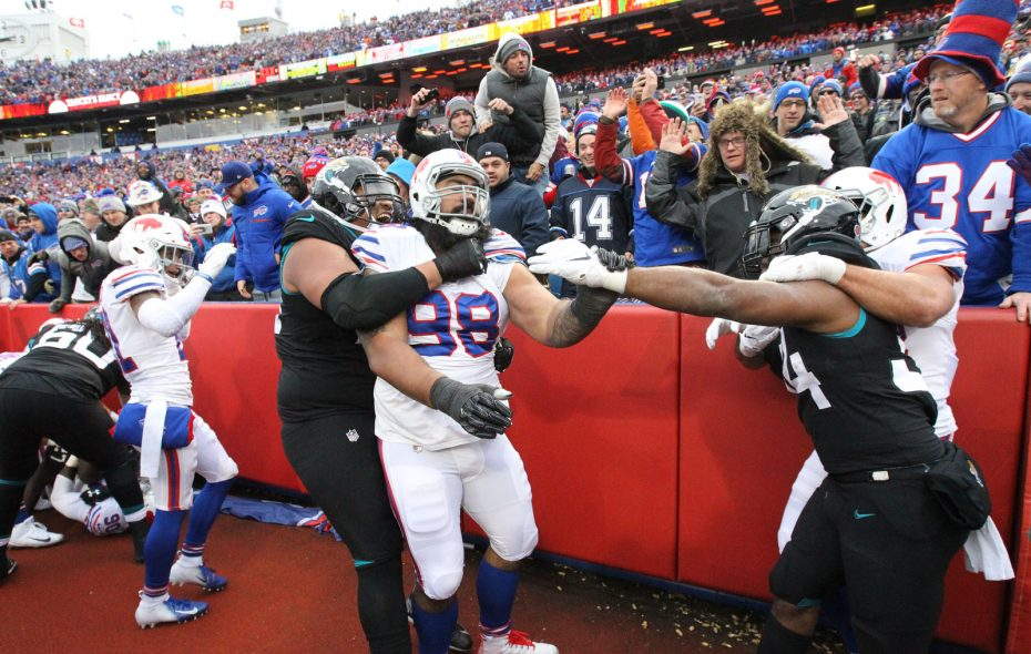 Players from both teams scuffle after a controversial play near the end zone during the third quarter Sunday at New Era Field in Orchard Park. Jacksonville's Leonard Fournette and Buffalo's Shaq Lawson were ejected from the game. (James P. McCoy/Buffalo News)