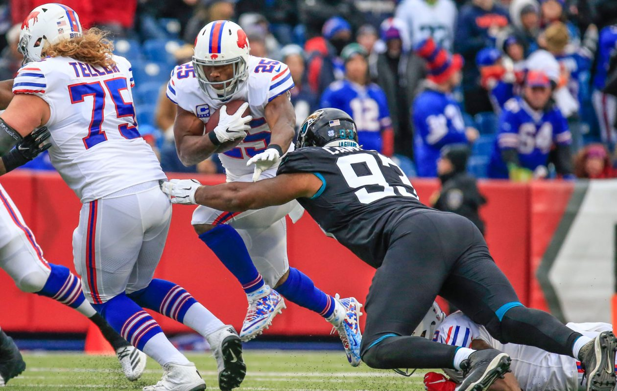 Buffalo Bills running back LeSean McCoy runs the ball against Jacksonville Jaguars defensive end Calais Campbell. McCoy was hit near the line of scrimmage too much last season. (Harry Scull Jr./News file photo)