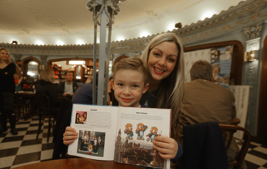 """Elliot Paone and his mother Melissa from Wheatfield show off his photo in a new children's book about of Buffalo titled """"Buffalo From A to Z: Come Take a Tour With Me."""" (John Hickey/Buffalo News)"""