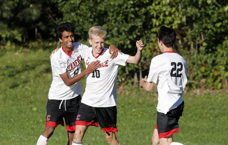 Clarence's Taha Ahmed, left, Nathan Vesper, center, and Ross Showalter celebrate a goal. Clarence won the Class AA sectional title  (Mark Mulville/Buffalo News)