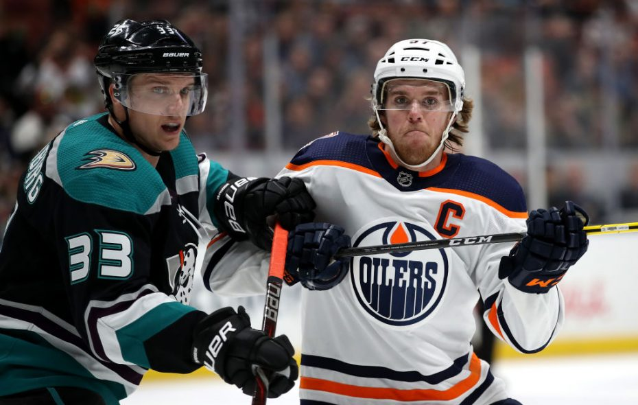 Connor McDavid (right) battles Jakob Silfverberg of Anaheim during Edmonton's 2-1 overtime loss to the Ducks Friday night. (Getty Images)