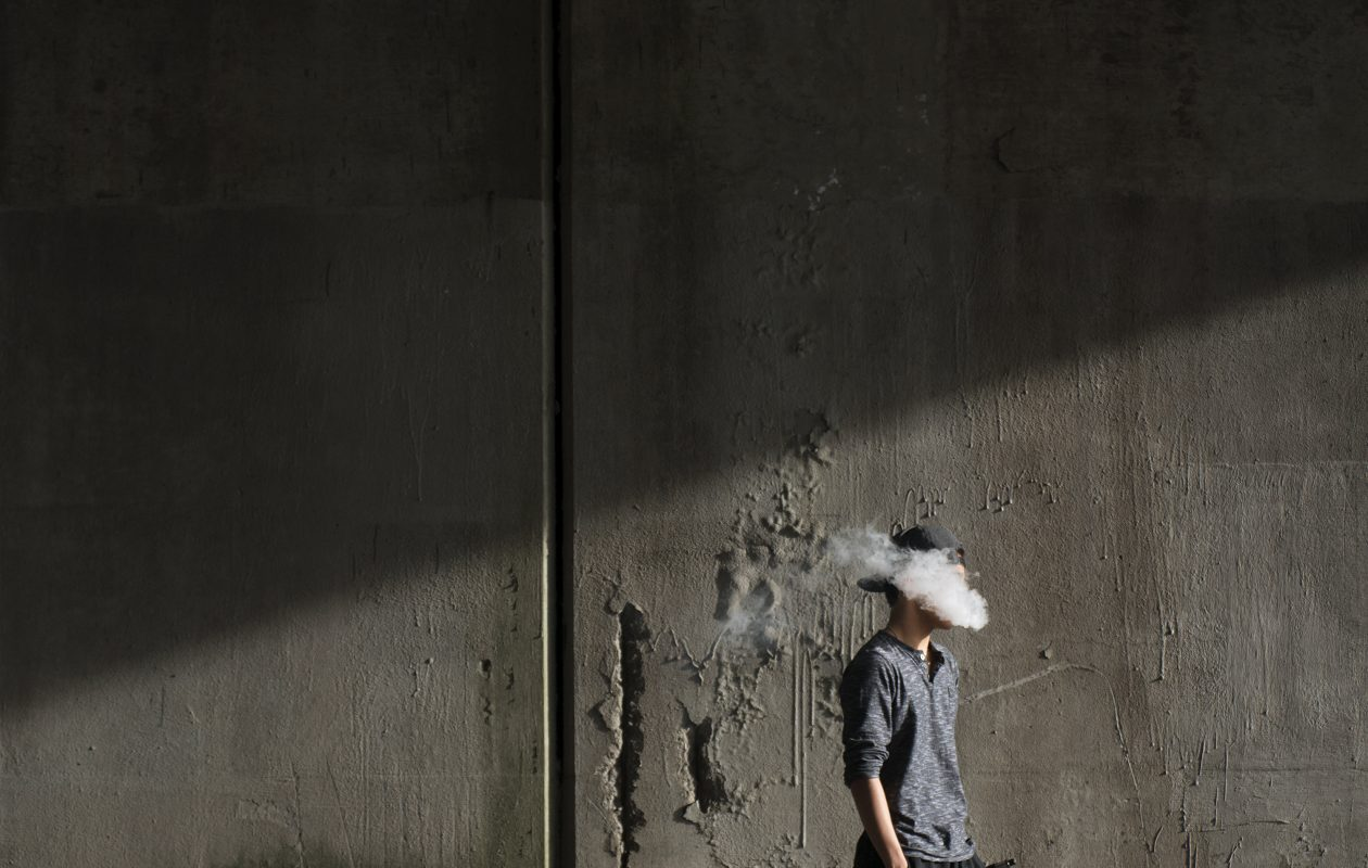A 15-year-old boy vapes in Peekskill, N.Y., April 16, 2015. (Bryan Thomas/The New York Times)