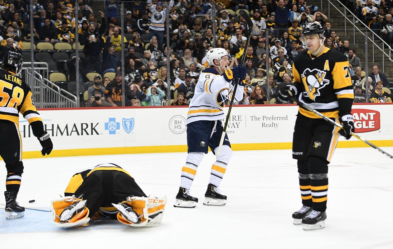 Jack Eichel reacts after scoring the game-winning goal during overtime to give the Buffalo Sabres a 5-4 win over the Pittsburgh Penguins Monday at PPG PAINTS Arena in Pittsburgh. (Justin Berl/Getty Images)