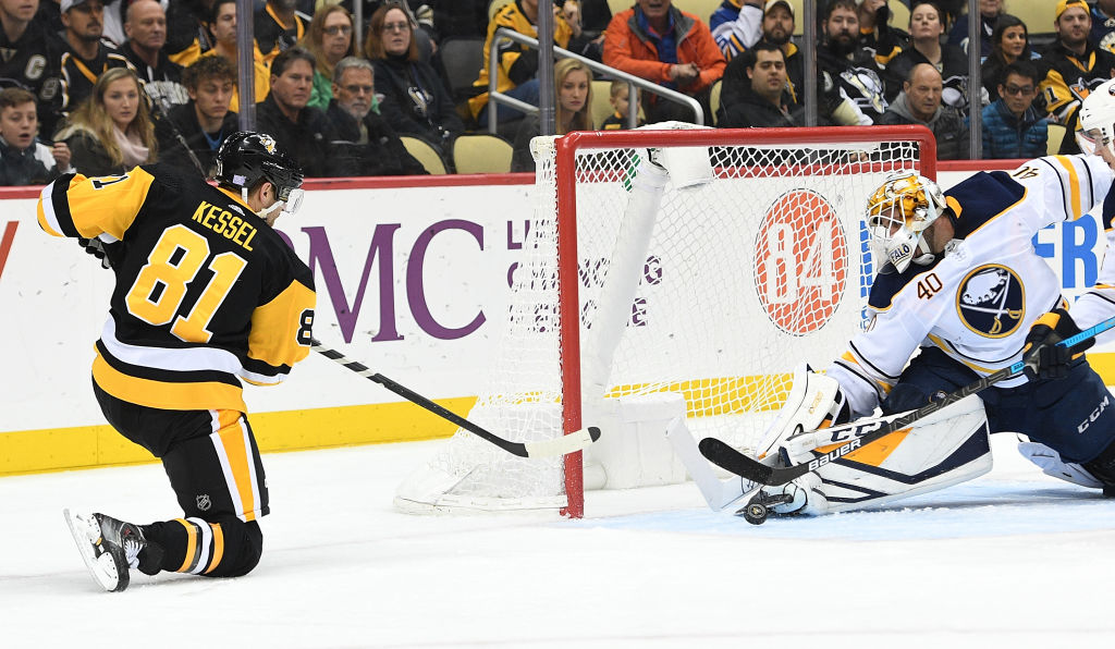 Sabres Carter Hutton makes a save on a shot by the Penguins  Phil Kessel in 050285ffb
