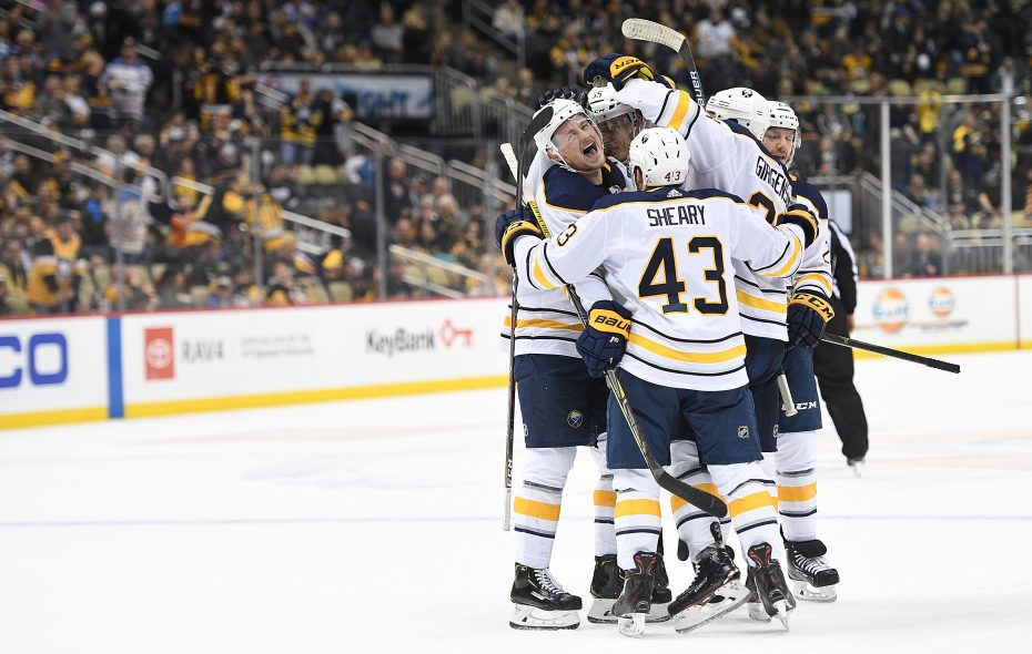 Jack Eichel (9) is surrounded by his Buffalo Sabres teammates after scoring the game-winning goal during overtime to give the Sabres a 5-4 win over the Pittsburgh Penguins at PPG PAINTS Arena on Nov. 19, 2018, in Pittsburgh. (Getty Images)
