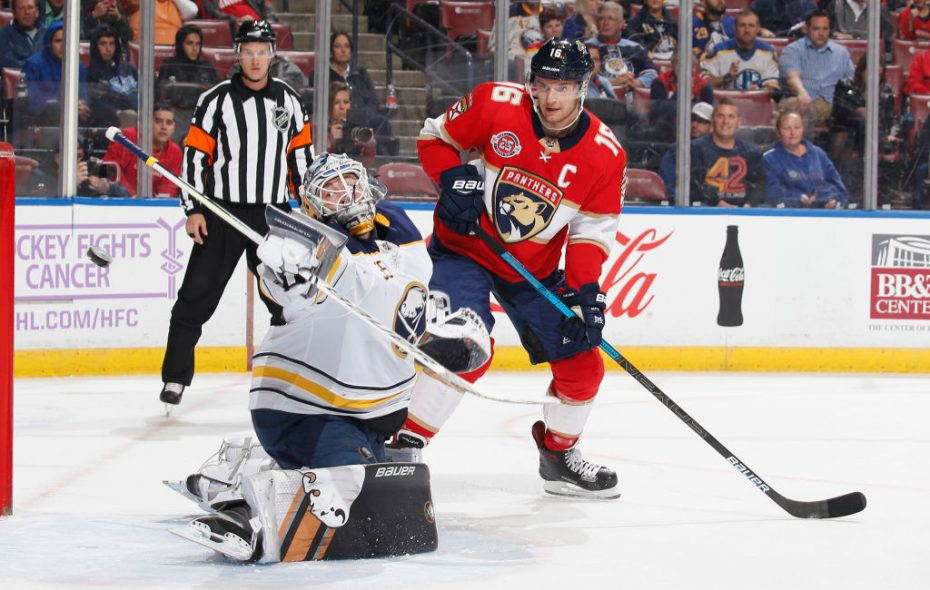 Aleksander Barkov of the Florida Panthers looks on as Goaltender Linus Ullmark of the Buffalo Sabres deflects a shot during first period action on Nov. 30, 2018 in Sunrise, Fla. (Photo by Joel Auerbach/Getty Images)
